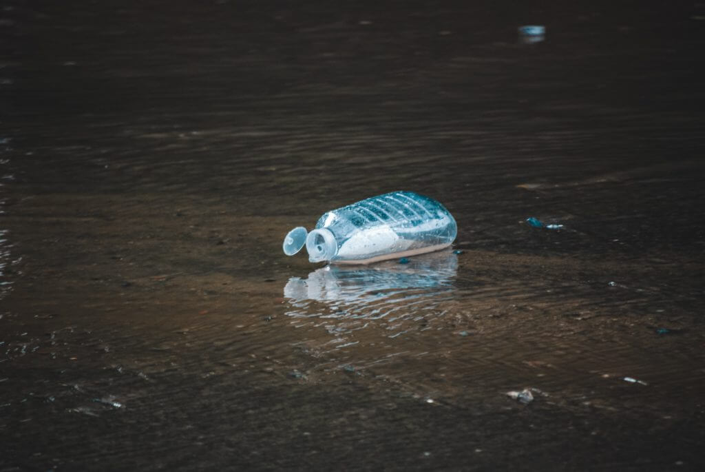 a plastic bottle thrown on the street
