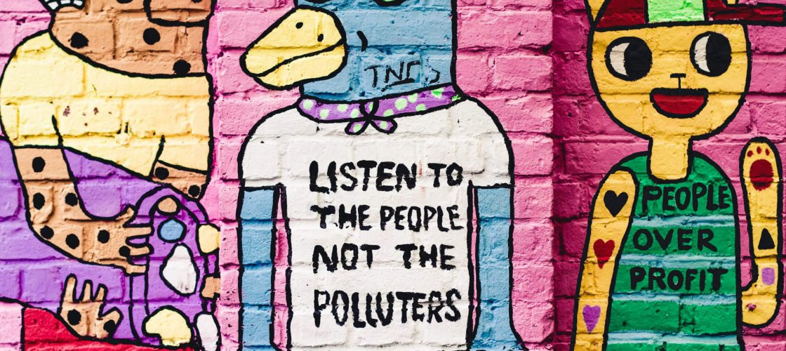 a street art saying Listen to the people, not the polluters